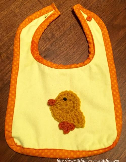 Fabric Bib with Crochet Appliqué. https://www.itchinforsomestitchin.com